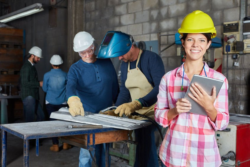 96861735 - young woman as worker apprentice or trainee with tablet computer